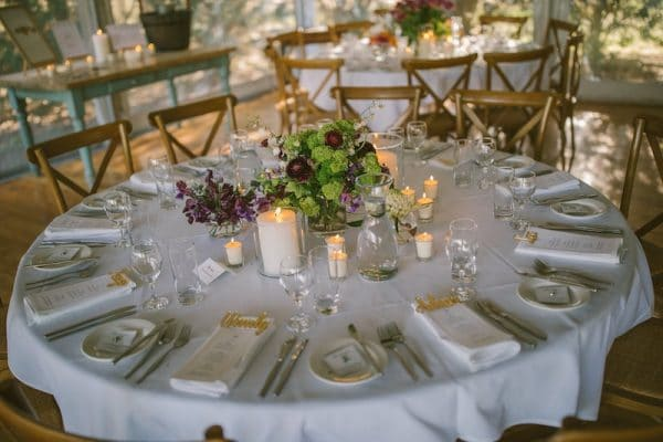 1.8M-Round-Table-Princess-Cutlery-White-Linen-Glassware-Timber-Cross-Back-Chairs