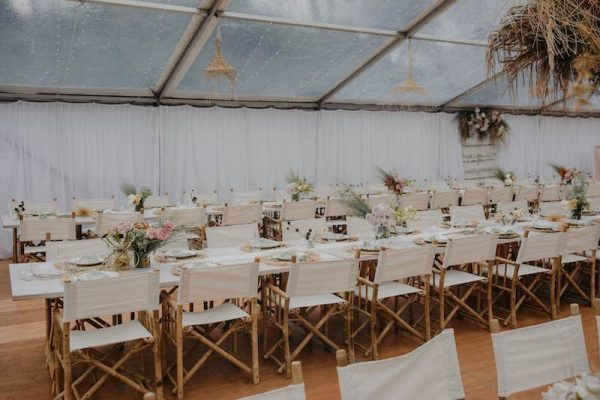 Bamboo-Directors-Chair-White-White-Timber-Trestle-10m-Marquee-Clear-Roof-Silk-Lined-Wall